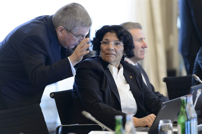 International Olympic Committee (IOC) president Thomas Bach, of Germany, left, speaks with Member of the International Olympic Committee, IOC, Anita DeFrantz, of the US, right, at the opening of the second and last day of the executive board meeting of the International Olympic Committee (IOC), in Lausanne, Switzerland.