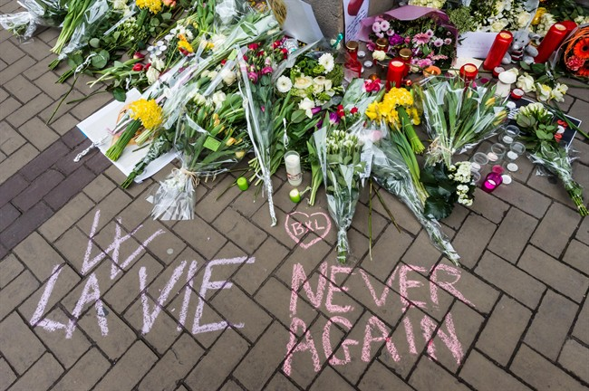 A makeshift memorial near the entrance of metro station Maelbeek in Brussels, Belgium, Thursday, March 24, 2016.