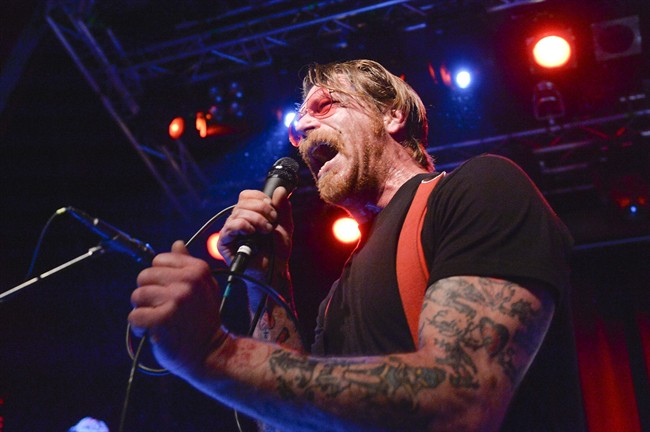 Singer Jesse Hughes, pictured Feb. 13, 2016, is apologizing for suggesting that security guards at a Paris concert venue were complicit in the assault by Islamic militants there in November that left 89 people dead.