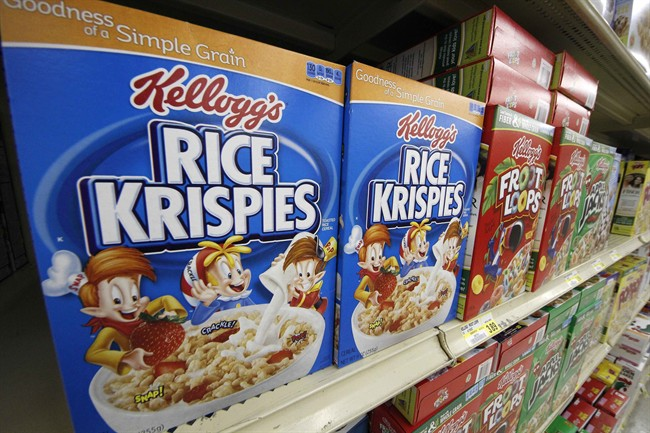 In a July 18, 2012, file photo, Kellogg's cereals are on display at a Pittsburgh grocery market. Kellogg says a criminal investigation is underway after a video surfaced online showing a man urinating on one of its factory assembly lines.