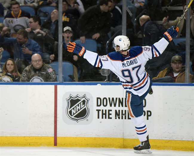 Edmonton Oilers center Connor McDavid celebrates his overtime goal against the Buffalo Sabres in an NHL hockey game Tuesday, March 1, 2016, in Buffalo, N.Y. Edmonton won 2-1.