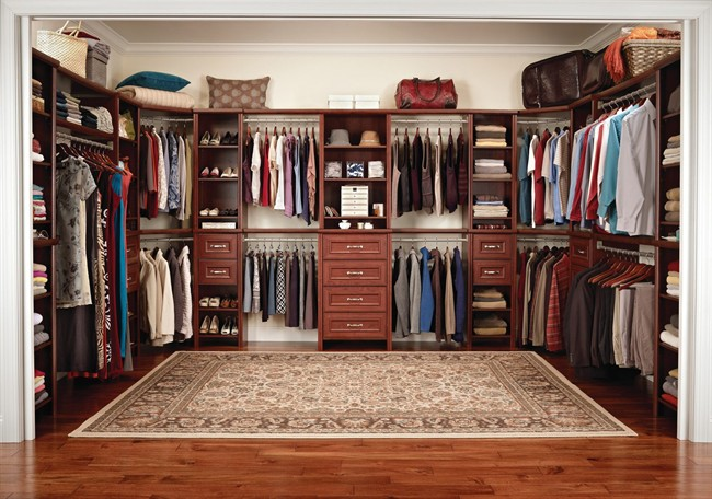 This closet organization system  offers a built-in appearance, but can be removed to be used elsewhere if the homeowner's needs change.