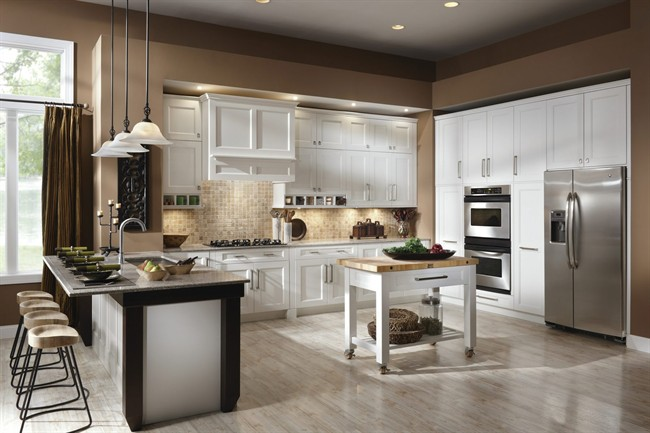 """The era of the """"super kitchen'' has arrived, say interior designers and trend-watchers: People are building or remodeling kitchens that include work and entertainment space, too."""