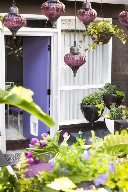 If you love bold colors but worry they'd be overpowering on your front door, consider putting a striking shade on a side door, as shown in this photo of a house designed by Brian Patrick Flynn.