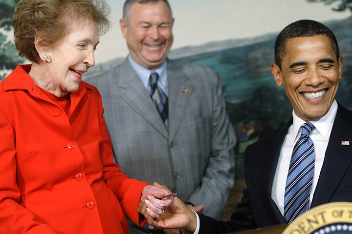 Former first lady Nancy Reagan and President Barack Obama smile after Obama presented her with a pen after signing the Ronald Reagan Centennial Commission Act, Tuesday, June 2, 2009.