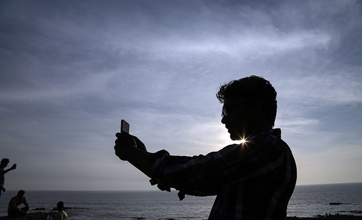 A man is seen taking a selfie in this February 25, 2016 file photo.