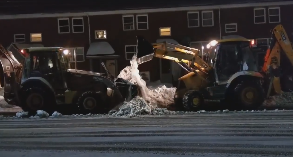 Two snow plows clear snow from Gottingen Street in Halifax on Jan. 21, 2016.