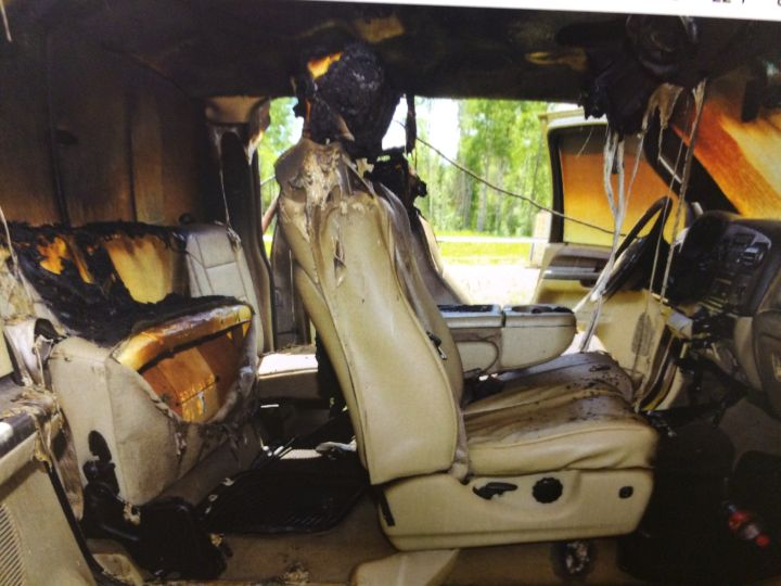 A photo of a burned out pickup truck is submitted as evidence in Travis Vader's murder trial.