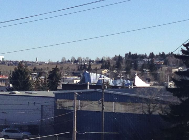 A roof is damaged on a building in northeast Calgary after severe wind gusts Thursday.