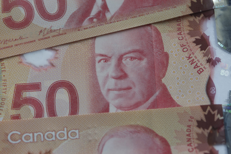 Tax evasion prosecutions fell by almost half across Canada in a three-year period, figures released by the federal justice department show.