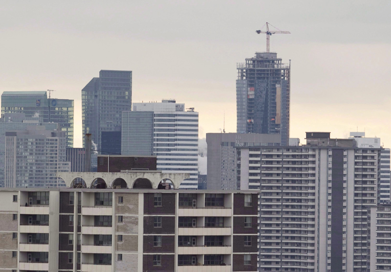 A construction crane sits atop a highrise building in Toronto in this file image.