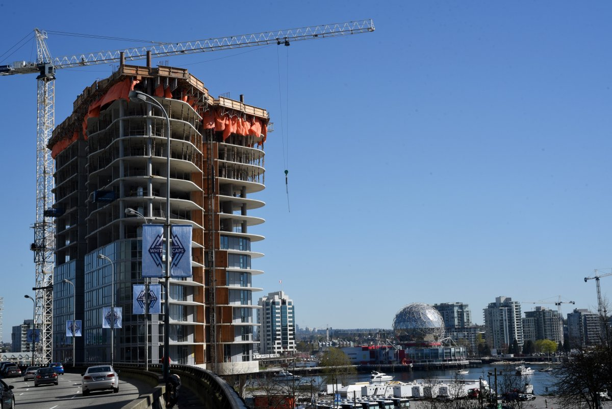 One of the three towers of the Aquilini Centre under construction next to the Georgia Viaduct on April 1, 2016 in Vancouver, British Columbia.  The tower will contain commercial space and residential rental units. BC's poorest residents spend 70% of their income on housing.