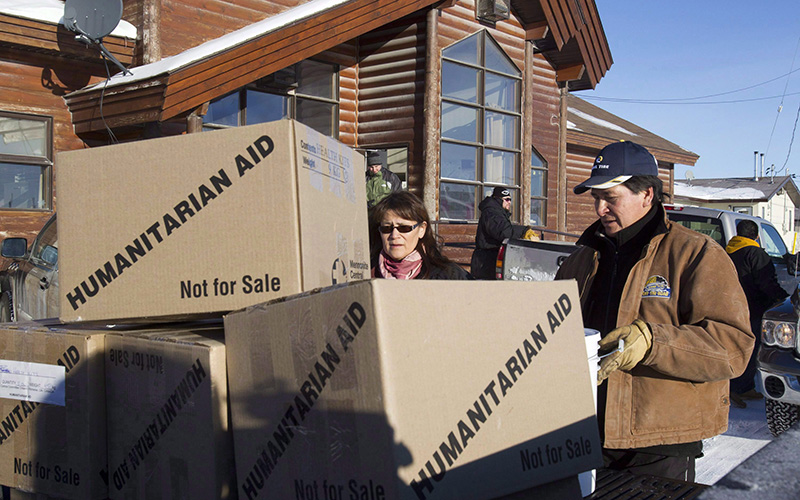 Humanitarian aid is unloaded in Attawapiskat, Ont. Teams of mental health workers have travelled to Attawapiskat to help the remote northern Ontario reserve contend with an epidemic of suicide attempts among its young people.