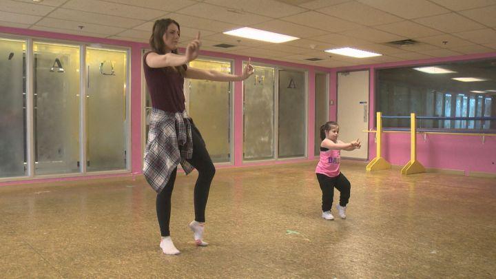 Ana Malaniuk (R) dances with her teacher Shae-Lyn Bates Friday, April 1, 2016.
