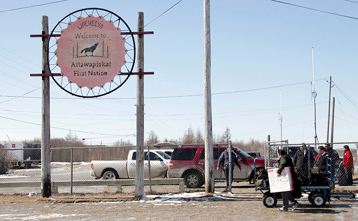 A sign welcomes visitors at the Attawapiskat airport in the remote northern Ontario community on Monday, April 18, 2016. In many ways, Attawapiskat - population 2,100 - has all the trappings of any small town, including older folk lamenting the changing of the times.
