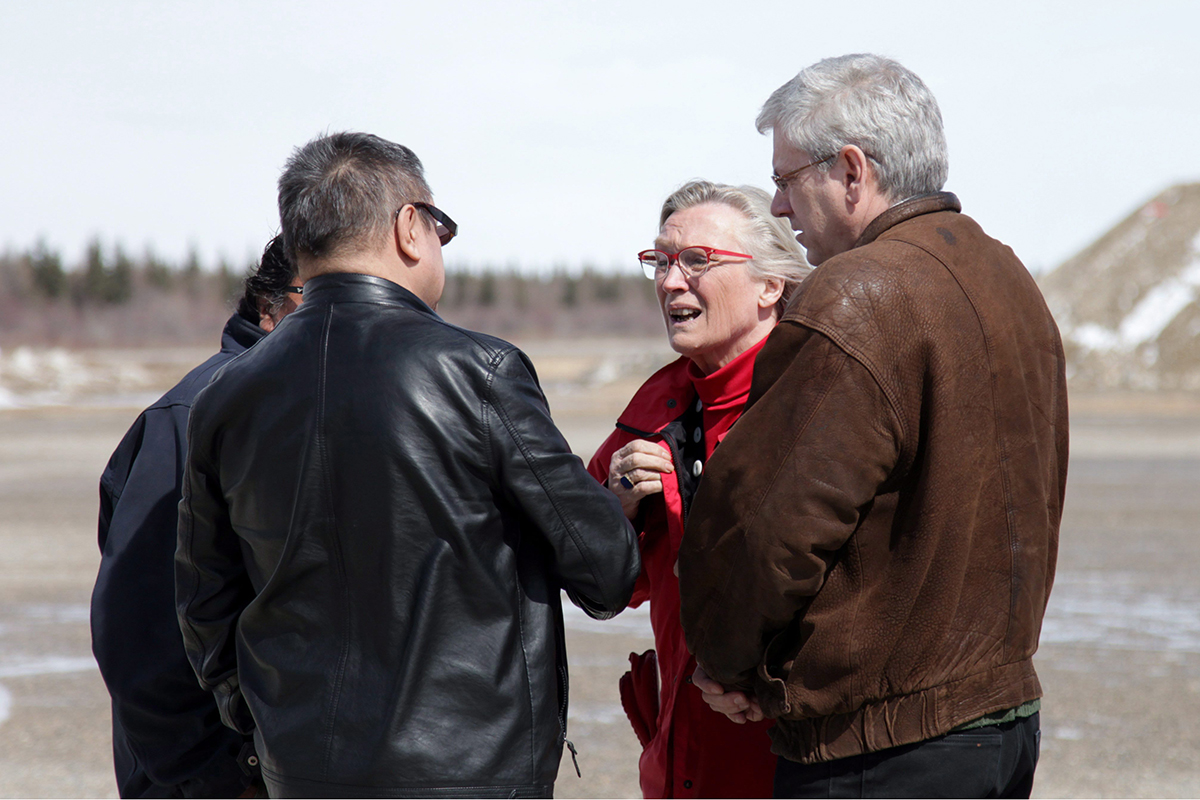 Indigenous Affairs Minister Carolyn Bennett is greeted at the Attawapiskat airport by Chief Bruce Shisheesh on Monday, April 18, 2016, as NDP MP Charlie Angus (right) looks on.