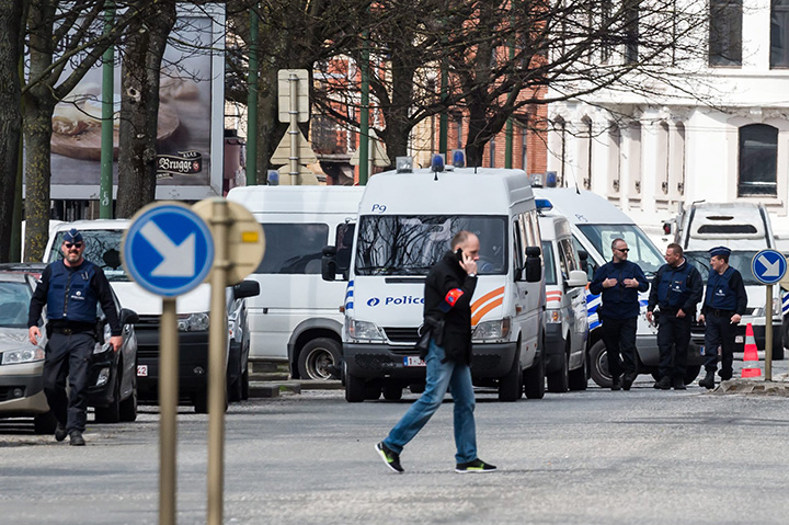 Police secure an area during a house search in the Etterbeek neighbourhood in Brussels on Saturday April 9, 2016.