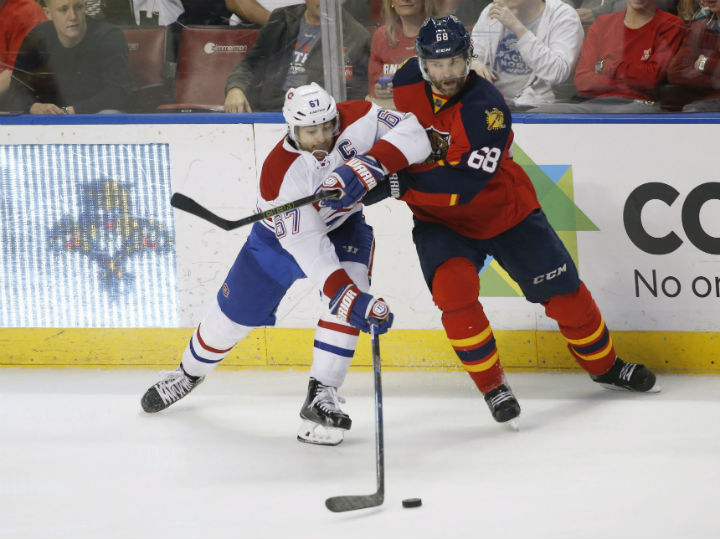 Montreal Canadiens left wing Max Pacioretty (67) and Florida Panthers right wing Jaromir Jagr (68) battle for the puck during the third period of an NHL hockey game, Saturday, April 2, 2016.
