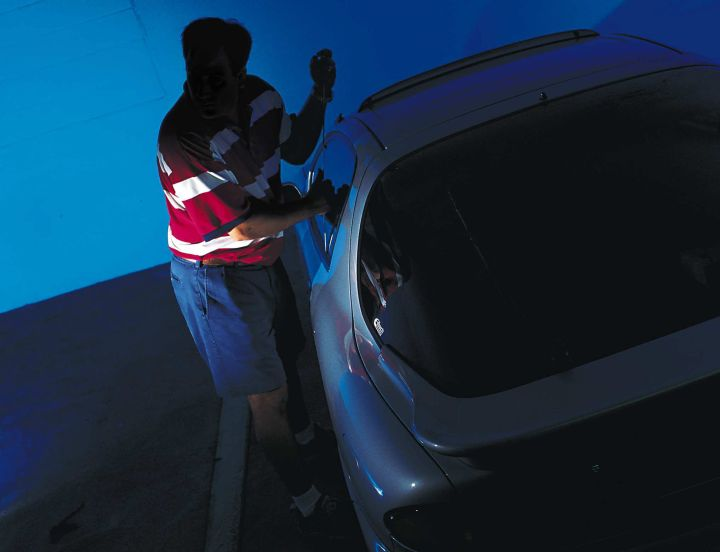 A photograph illustrating a car break-in.