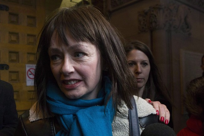 Lucy DeCoutere leaves the Toronto courthouse following the reading of the verdict in the Jian Ghomeshi sexual assault trial on Thursday, March 24, 2016.