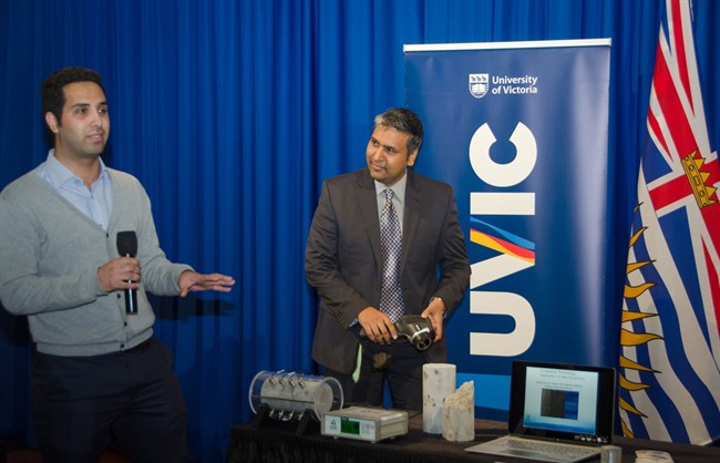 Pejman Azarsa (left), UVic PhD candidate and Dr. Rishi Gupta demonstrate BCKDF and CFI-funded electrical resistivity meter on concrete cylinders, at BCKDF funding announcement at the B.C. Legislature, Monday April 4, 2016. Scientists at the University of Victoria are working to cement their lead in making so-called smart concrete that heals and seals cracks, greatly reducing potential infrastructure disasters and extending lifespans of buildings and structures.