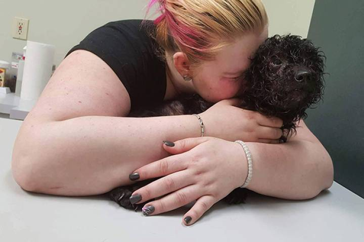 Amber Kimmerly says her poodle Ozzy had to be euthanized after it was found severely beaten in her backyard.