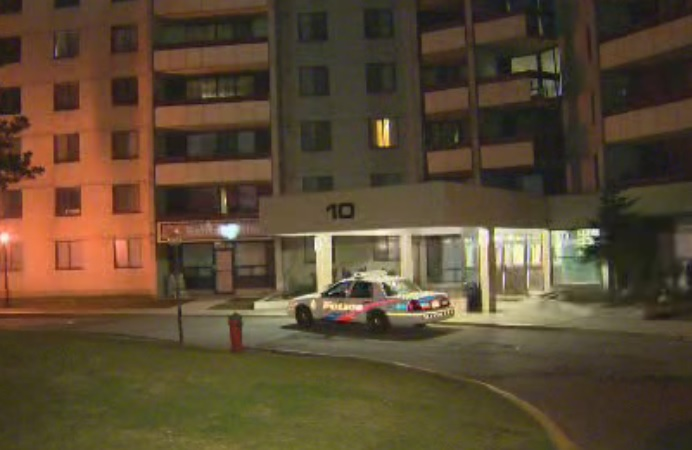 Police investigate an unprovoked assault at an apartment building in Toronto on April 27, 2016.