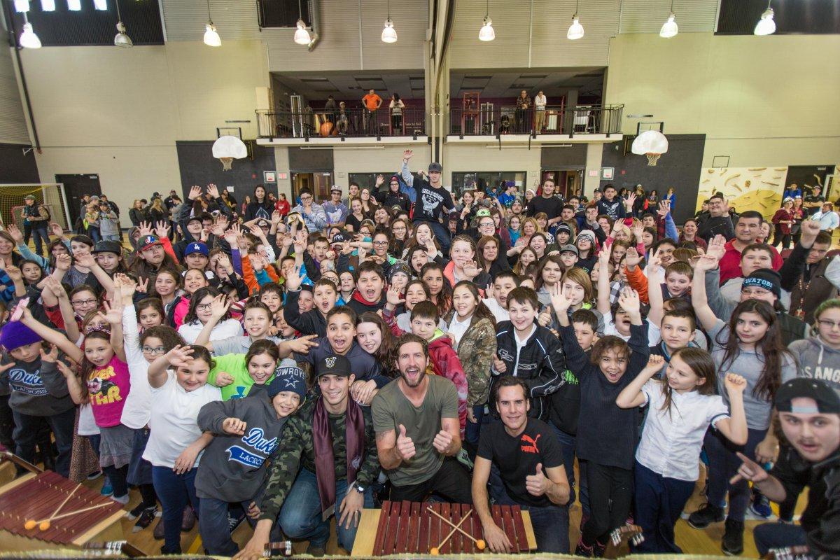 Singer Jonas, guitar player Corey Diabo and Montreal Canadiens goaltender Carey Price visit students at Kahnawake Survival School , Wednesday, March 23, 2016.