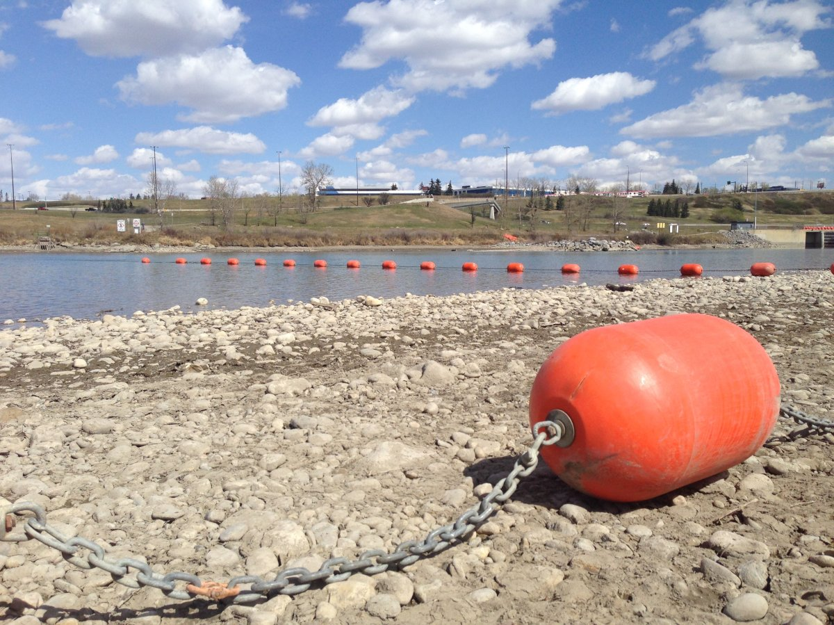 Safety booms installed Saturday at Harvie Passage on the Bow River in 2016.