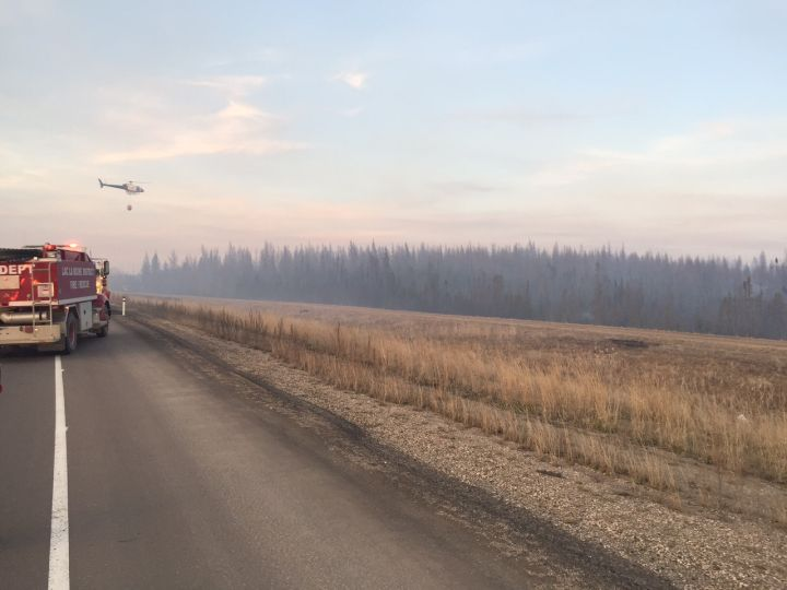 Fire crews battle a wildfire near Boyle, Alta. on April, 18, 2016. The blaze  left Highway 63 impassable for a couple of hours.
