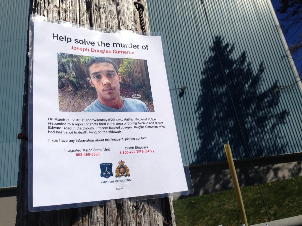 A poster asking for help solving the Joseph Cameron homicide.