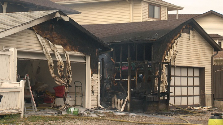 Fire destroys one garage and damages two others in Marlborough Wednesday afternoon.