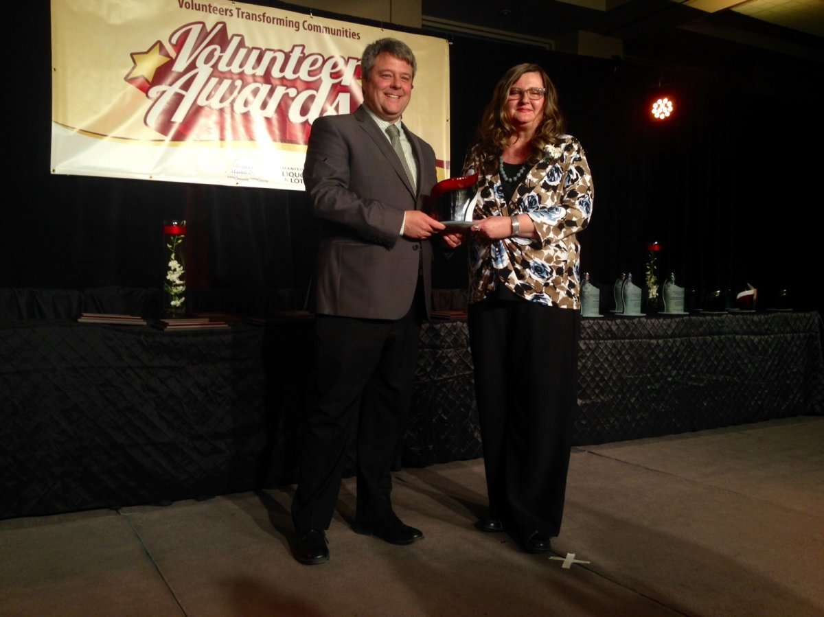 Global station manager Brent Williamson presenting the award to Milena Pirnat at the Annual Volunteer Awards in 2016.