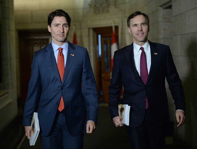 Minister of Finance Bill Morneau is accompanied by Prime Minister Justin Trudeau as he makes his way to deliver the federal budget in the House of Commons on Parliament Hill in Ottawa on Tuesday, March 22, 2016.
