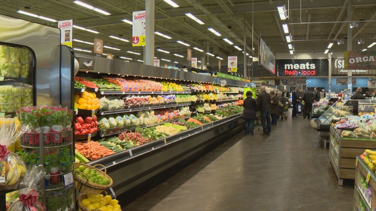 Shoppers check out the produce section at the province's first Save On Foods.