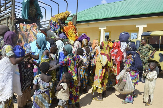 Women and children rescued by Nigerian soldiers from Boko Haram arrive in a military office in Maiduguri, Nigeria in this July 30, 2015 file photo.