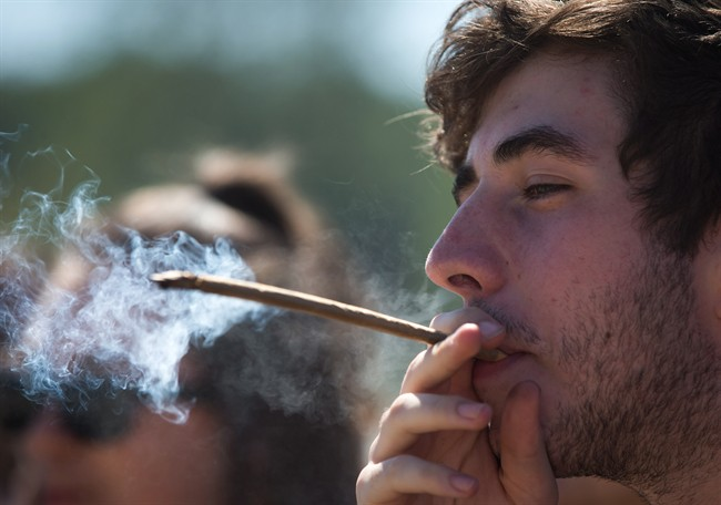 FILE PHOTO: A man smokes during the annual 4/20 cannabis culture celebration at Sunset Beach in Vancouver, B.C.