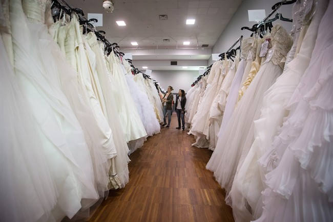 Women browse wedding dresses for sale at the Original Bridal Swap at the Croatian Cultural Centre in Vancouver, B.C., on Sunday April 3, 2016.