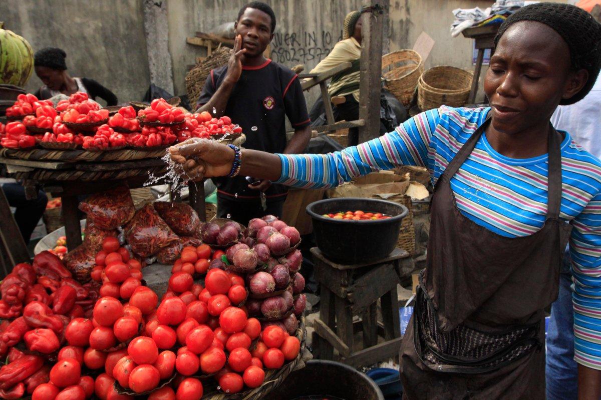 Women sells tomatoes at a market in Obalende, Lagos, Nigeria, Saturday, Jan. 14, 2012.