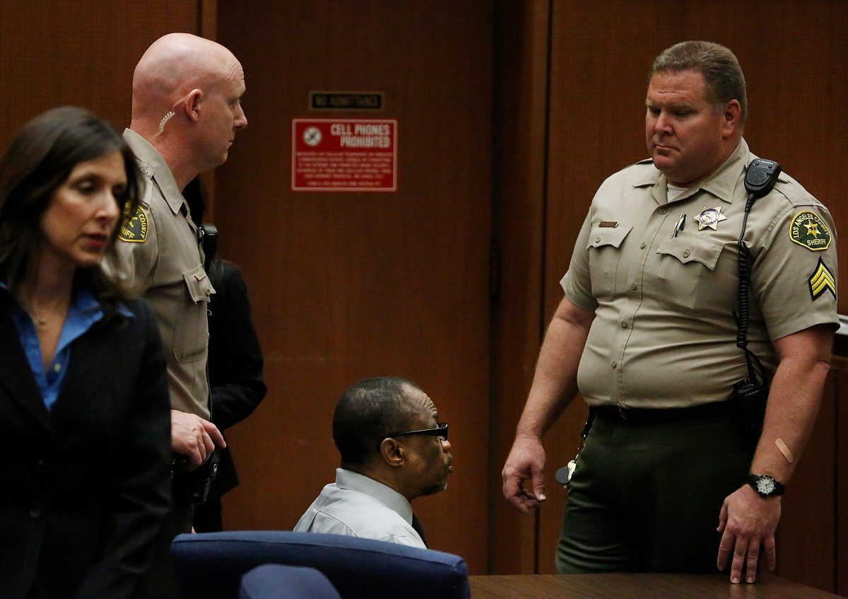 """Lonnie Franklin Jr., center, sits in count in Los Angeles, Thursday, May 5, 2016. The former trash collector in Los Angeles was convicted Thursday of 10 """"Grim Sleeper"""" serial killings that spanned two decades and targeted vulnerable young black women in the inner city."""