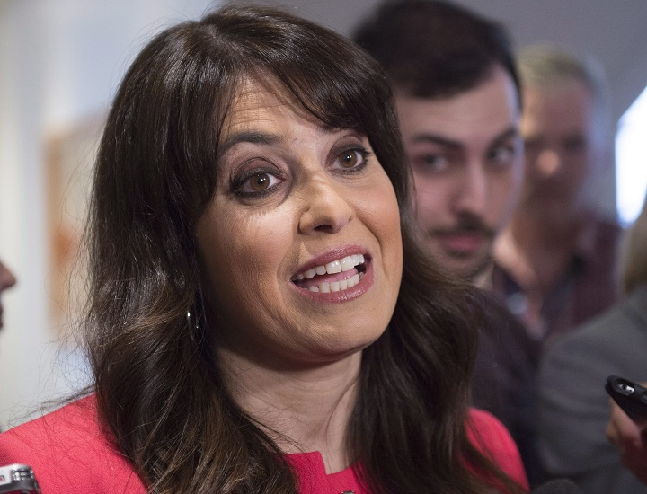 Parti Québécois MNA Véronique Hivon responds to reporter questions, Friday, May 6, 2016 at the entrance of a special caucus meeting in Quebec City.