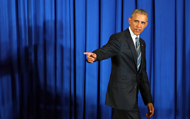 US President Barack Obama leaves the stage after a press conference at the International Convention Center in Hanoi, Vietnam, 23 May 2016.