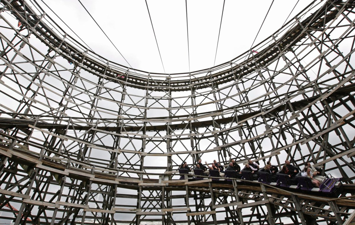 People ride the Playland Wooden Coaster during a celebration of its 50th birthday in Vancouver, B.C., on Tuesday June 17, 2008.