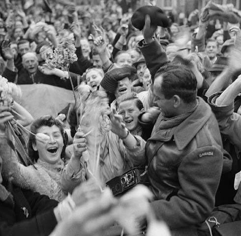 Crowd of Dutch civilians celebrating the liberation of Utrecht by the Canadian Army, May 7, 1945.
