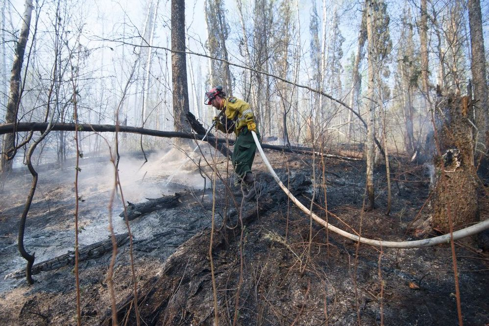 Firefighters battle a wildfire near Fort McMurray.