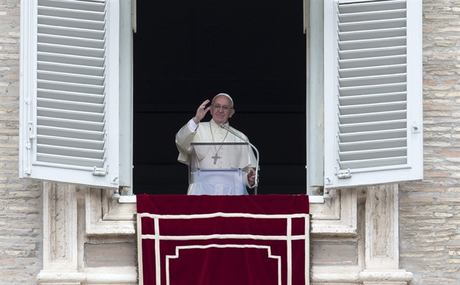 Pope Francis delivers his blessing during the Regina Coeli prayer from his studio's window overlooking St. Peter's Square, at the Vatican, Sunday, May 1, 2016.