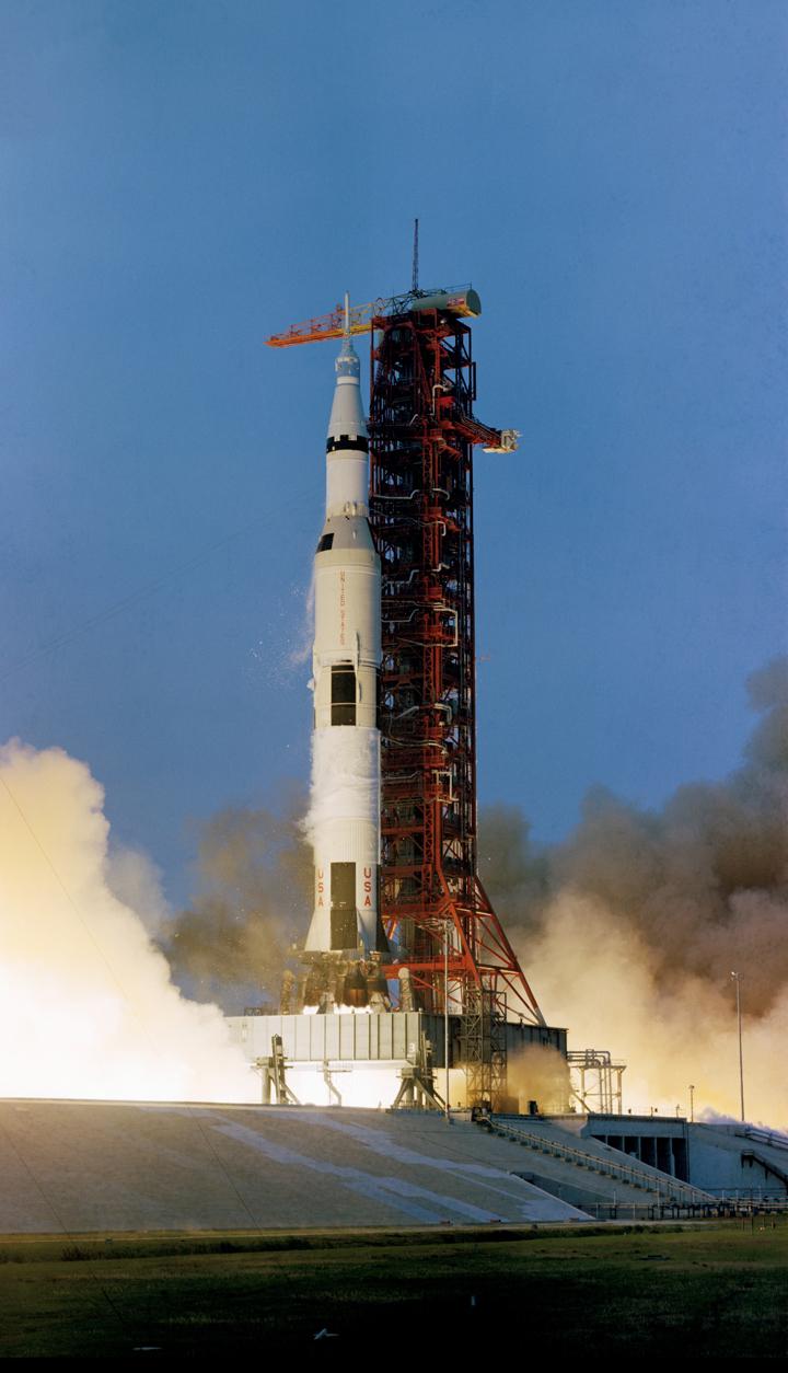 Apollo 13 lifts off