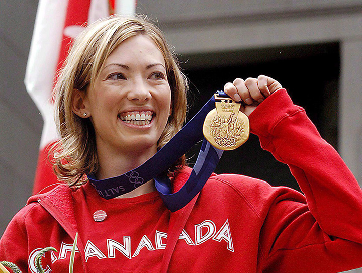 Canadian cross-country skier Beckie Scott displays her gold medal she was awarded at a ceremony in Vancouver on June 25, 2004.