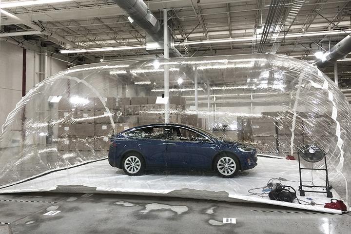 """According to Tesla's blog, researchers put a Model X in a car-sized bubble and exposed it to """"extreme levels of pollution"""" – about 100 times more contaminated than what the U.S. Environmental Protection Agency classifies as """"good.""""."""