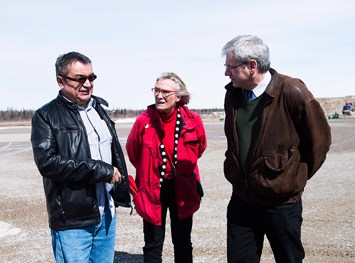 Chief Bruce Shisheesh, left, Minister of Indigenous Affairs Carolyn Bennett, centre, and Federal NDP MPP Charlie Angus, right, meet in the northern Ontario First Nations reserve in Attawapiskat, Ont., on Monday, April 16, 2016.
